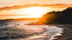 Gray Sand Beach during Sunset Stock Image
