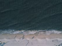 Gray Sand Near Body of Water royalty free stock images