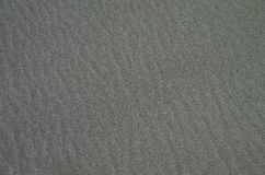 Gray sandy surface as background. Royalty Free Stock Photos