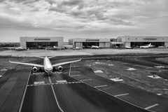 Gray Scale of Air Plane on Runway Under Cloudy Day Royalty Free Stock Photos
