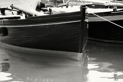 Gray Scale Photo of Boat on Body of Water Stock Images