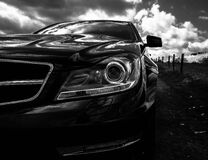 Gray Scale Photo of Car on Side of the Road Royalty Free Stock Photos