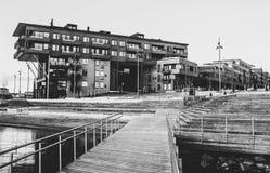 Gray Scale Photo of a Dock Near a Building Stock Photos