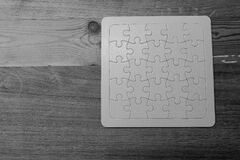 Gray Scale Photo of Jigsaw Puzzle Stock Images