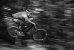 Gray Scale Photo of Person Riding Bike Royalty Free Stock Photos