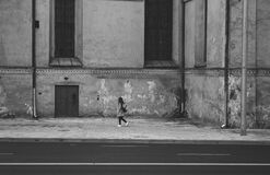 Gray Scale Photography of Woman Walking Near High Rise Building Royalty Free Stock Images