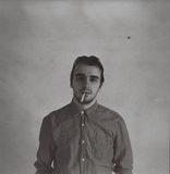 Gray Scale Picture of Man in Dress Shirt With Cigarette Stock Photo