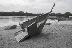 Gray Scale Playground. Wooden playground by the water Royalty Free Stock Photography