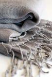 Gray Scarf. Folded gray scarf with fringe stock photo