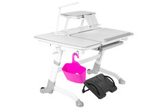 Gray school desk, pink basket, desk lamp and black support under legs Stock Photo