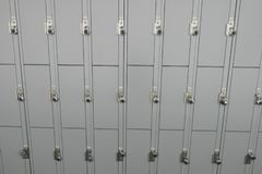Lockers. Gray school lockers in a hallway with locks stock photos