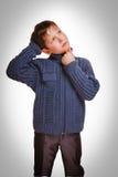 Gray schoolboy blond boy kid training education idea scratching Royalty Free Stock Photo