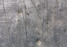Gray scratched metal surface. Stock Photography