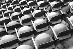 Gray seats in the stands. Gray empty seats in the stands before the sporting event Stock Images