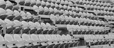 Gray seats in the stands before the sporting event Stock Photo