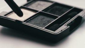 Gray shades of eyeshadow,Close up of makeup brush moving over eye shadows. Close up of makeup brush moving over eye shadows.Gray shades of eyeshadow, Close-up stock video
