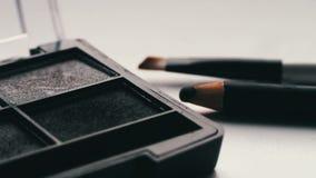 Gray shades of eyeshadow,Close up of makeup brush moving over eye shadows. Close up of makeup brush moving over eye shadows.Gray shades of eyeshadow, Close-up stock footage