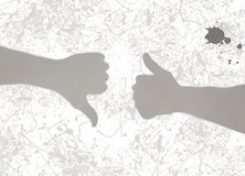 Gray shadows of two hands - thumbs up and thumbs down Stock Photos