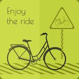 Gray shape bicycle on the road with road sign Royalty Free Stock Photo