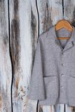Gray shirt on wooden hanger Stock Photography