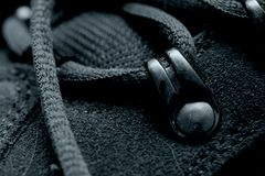 Gray Shoelaces. Close in view of gray shoelaces and eyelets of a shoe Royalty Free Stock Image