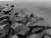 Gray shoreline. A rocky shoreline on the lake stock photos