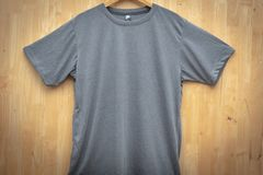 Gray short sleeve t-shirt plain round neck mock up concept idea wooden back ground  front view stock photo