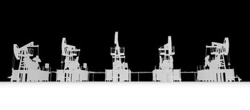 Gray silhuettes of oil pump-jacks. Front view Royalty Free Stock Photos