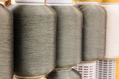 Gray silk thread in spool Royalty Free Stock Image