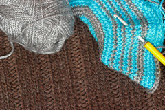 Gray silky yarn with striped crochet hook Royalty Free Stock Images
