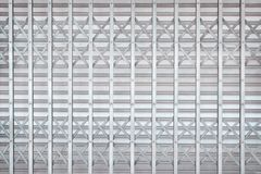 Gray or silver rolling steel door or roller shutter door in interlace patterns for background royalty free stock image