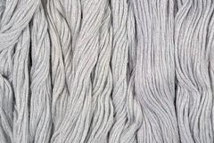 Gray skeins of floss as background texture Royalty Free Stock Image