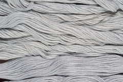 Gray skeins of floss as background texture Stock Photo