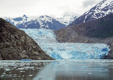 Gray Skies at Tracy Arm. The Tracy Arm glacier stretches into the ocean Stock Photo