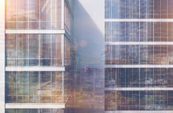 Gray skyscraper exterior, front, double. Front view of an exterior of a gray skyscraper with large windows and a gigantic poster between them. 3d rendering, mock Stock Photos