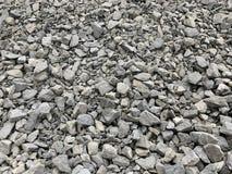 Gray small granite crumb, building material, simple background stock image