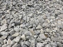 Gray small granite crumb, building material, simple background royalty free stock image