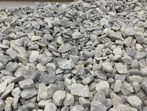 Gray small granite crumb, building material, simple background stock photo