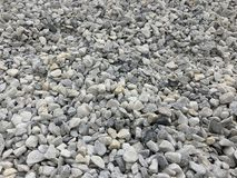 Gray small granite crumb, building material, simple background stock photography