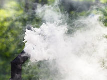 Gray smoke from oven chimney Stock Images