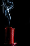 Gray smoke from the red candle that went out Royalty Free Stock Photography