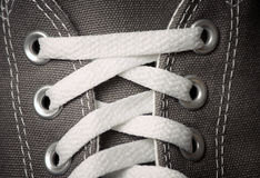 Gray sneakers classic youth footwear Royalty Free Stock Photography