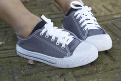 Gray sneakers with model lifestyle Stock Images
