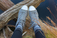 Gray sneakers on a trip Royalty Free Stock Photography