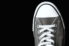 Gray sneakers youth footwear Royalty Free Stock Photos