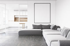 Gray sofa living room, poster, kitchen. White living room interior with a gray sofa, a framed vertical poster and a kitchen in the background. 3d rendering mock Royalty Free Stock Image