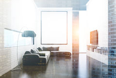 Gray sofa living room, TV set and poster toned Royalty Free Stock Photos