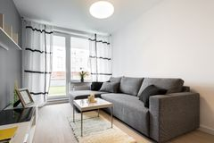 Gray sofa in modern living room Royalty Free Stock Photography