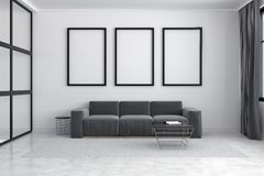 Gray sofa, poster gallery. White living room interior with a long sofa standing under three framed posters on a carpet on a concrete floor. 3d rendering mock up Royalty Free Stock Photo