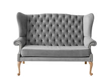 Gray soft sofa with fabric upholstery isolated on white Stock Images